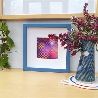 Framed woven paper artwork 'Beyond' in room setting