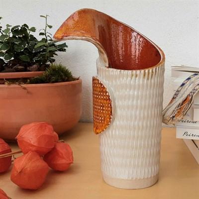 Harlequin ceramic vase with orange glaze side view