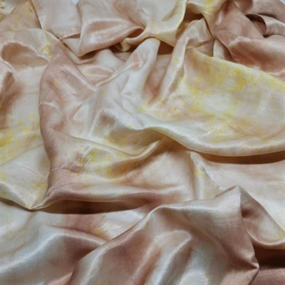 Naturally Bundle Dyed Silk Scarf, laid on a surface, you can see the shine of the silk
