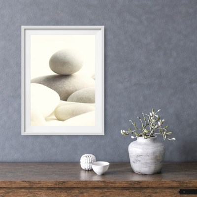 Photographic Art Print 'Serene Pebbles' shown framed in a room setting