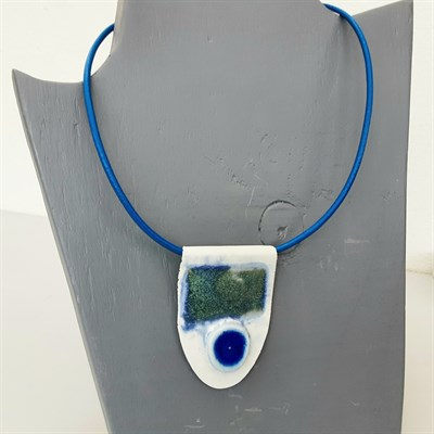 Porcelain necklace with blue feature on mannequin