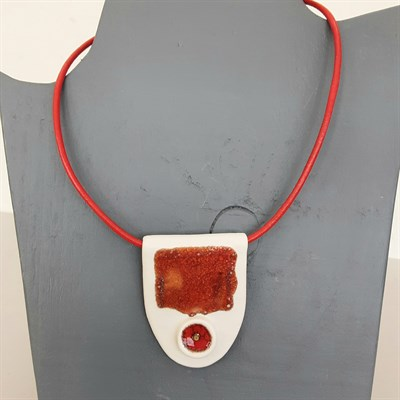 Porcelain necklace with red artwork on mannequin