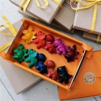 one open box of soy wax dinosaurs with gift wrapped boxes surrounding
