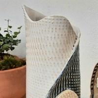 Blue/green single buttoned ceramic vase top detail