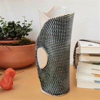 Blue/green single buttoned ceramic vase side view, empty