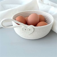 Cotton rope bowl with porcelain button trim filled with eggs