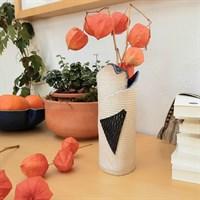 Harlequin ceramic vase with blue glaze