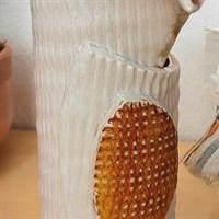 Harlequin ceramic vase with orange glaze detail