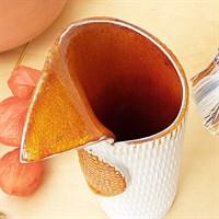 Harlequin ceramic vase with orange glaze from above