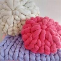 Merino wool round cushions and blankets