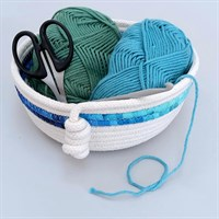 Rope bowl with blue fabric trim filled with wool and crochet hook gallery shot 3