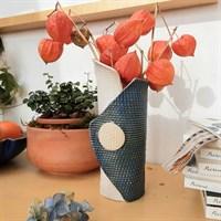 Single buttoned blue ceramic vase